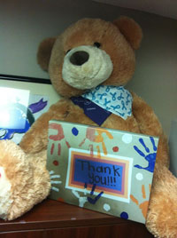 photo of our teddy bear with thanks sign